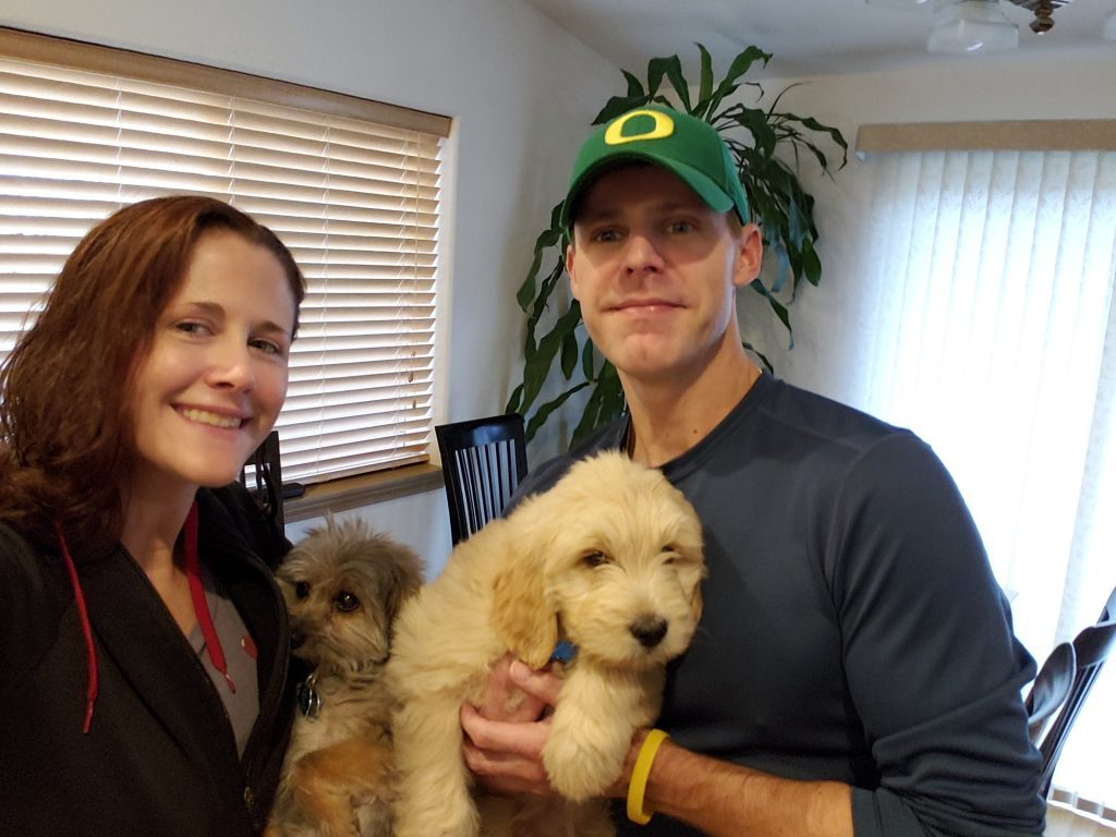 My wife and I holding our pups